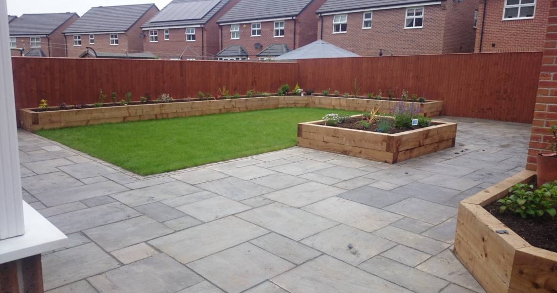 Paving In Garden With Planters